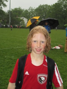 kids soccer in rain