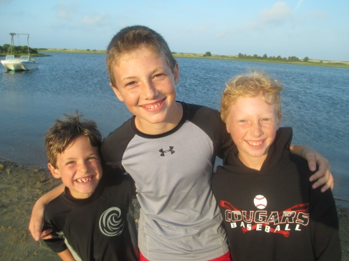 Boys smiling on Chappaquiddick, Martha's Vineyard on carpoolcandy.com
