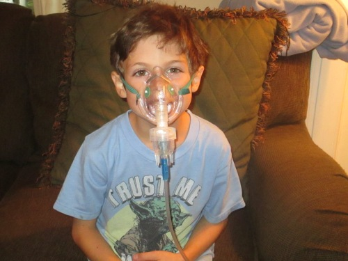 kid using nebulizer on carpoolcandy.com